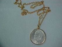 Gold tone necklace with ike dollar in Yucca Valley, California